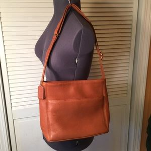 COACH | full-grain brown leather bag